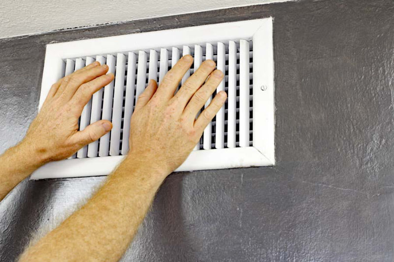 Hands in Front of Air Vent